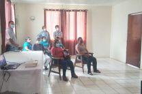 Miembros de la comunidad de la Mesa del Copé de Olá