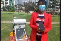 Ing. Rosilena Lindo, Directora del Proyecto del PNUD, presenta prototipo educativo de un calentador portátil.